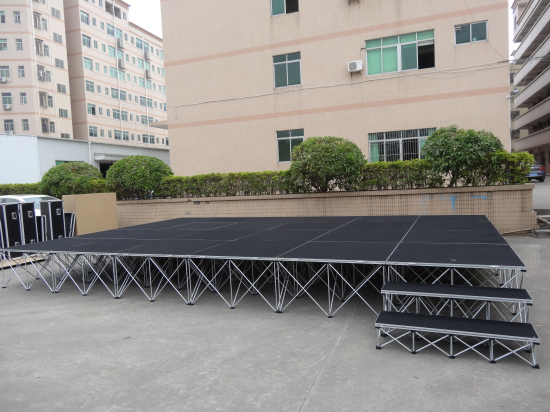 Used portable stage system with steps for outdoor stage events